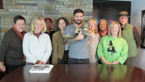 Left to right: Sara Smith, Furry Godmother; Susan Gibbons, Sara's Legacy Pet Sitters LLC; Roberta Werkema, K92Equine; Jennifer Loup, Canis Major Pet Sitting; Bub Bridavsky, Bub's Dad; Lil Bub; Martha Bautel, Happy Howels Pet Sitting; Jennifer Sepell, Under My Woof; Marsha Wheaton, Dog Mom At Your Service; Laurie Conney, 45th Parallel Pet Sitting.