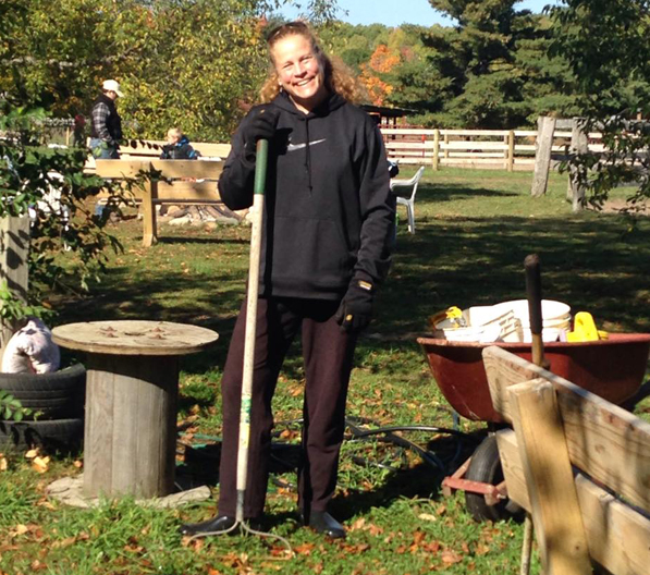 Volunteer Laurie Connie helps to widen the garden path. Photo credit: PEACE Ranch Facebook page.