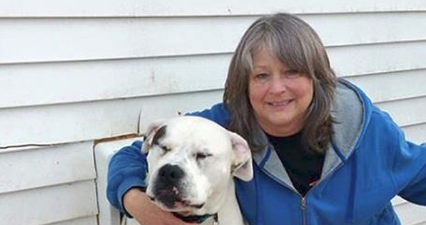 Lee Knorr and her American bulldog Roadie. Knorr said her three dogs and two cats drank Flint's toxic tap water for about a year before she bought a filter for her pets water. photo credit: http://www.mlive.com